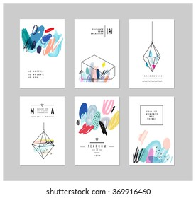 Set of creative cards with geometric outline shapes and crystals. Trendy hipster logotypes. Polygonal icons with artistic colored background. Vector. Isolated.