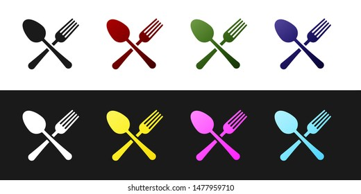 Set Crossed fork and spoon icon isolated on black and white background. Cooking utensil. Cutlery sign.  Vector Illustration