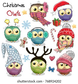 Set of cute cartoon Christmas owls on a white background