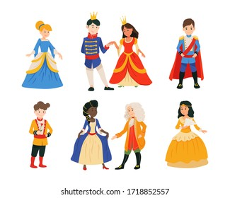 Set of cute little boys in prince costume with crown, girls in princesses dress isolated on white background. Сhildren at a costume ball, dressed as kings and queens, dancing in pairs. Little prince.