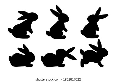 A set of cute rabbits. Black silhouette on a white background. Festive Easter bunnies. Vector illustration.