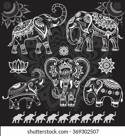 Set of decorated elephants on black