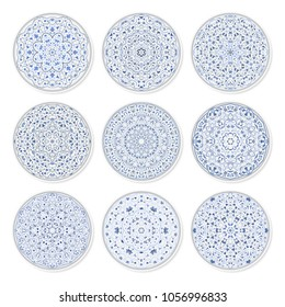 Set of decorative plates with a circular arabic blue pattern, top view. White background. Vector illustration.