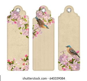 Set of decorative tags or bookmarks with the blooming spring branches and bird. Floral vector banners