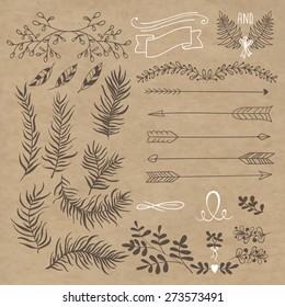 set design. Branches, arrows, plant elements for decoration. background crumpled kraft paper.