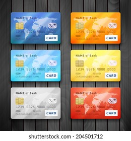 Set of detailed glossy credit cards, blue orange cyan yellow orange gold red color, vector realistic icons isolated on gray wood texture