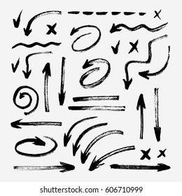 Set of different grunge brush strokes, arrows, underlinings, pointers. Hand drawn ink design.