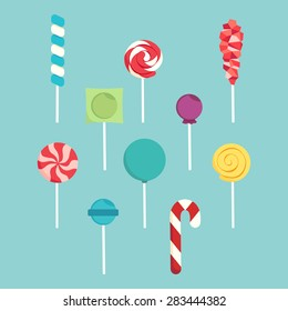 Set of different lollipops on a blue background.
