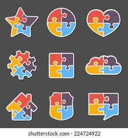 Set of different puzzle objects with four pieces, vector eps10 illustration