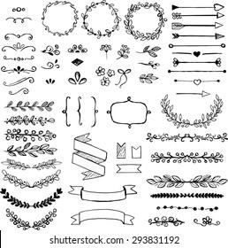 Set of doodle design elements. Arrows, wreath, floral elements