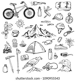 Set of doodle mountain camping design elements. Hand drawn vector illustrations isolated on a white background.
