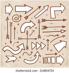 Set of doodle sketch arrows. Vector illustration.