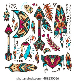 Set of doodles in a bohemian style. Vector design elements in a looks like a hand drawn illustrations. Bohemian and tribal elements: hearts, herbs, arrows, feathers, moon and crystal.