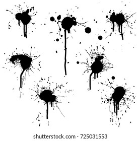 Set of dripping paint splatters