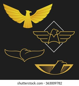 Set of eagles logo icon design. Abstract golden signs on the dark background.