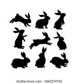 A set of Easter bunnies silhouette in different shapes and actions isolated on a white background.
