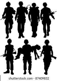 Set of editable vector silhouettes of walking soldiers