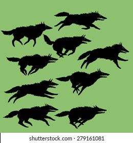 Set of editable vector silhouettes of wolves, running wolf pack