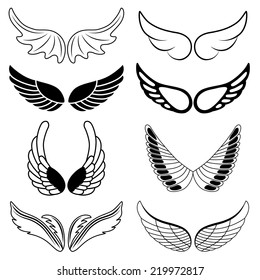 Set of eight black and white silhouettes of wings. Vector illustration