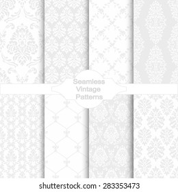 Set of eight seamless damask patterns. Classic grey wallpapers. Vintage vector backgrounds.