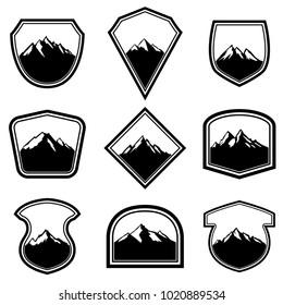 Set of empty badges with mountains. Design elements for logo, label, emblem, sign. Vector illustration