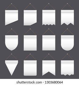 Set of empty white pennants of various shapes hanging on gray background