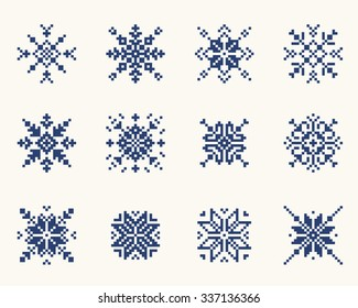 Set ethnic Slavic snowflakes. Red isolated on white background. Norwegian design. Cross stitch scheme.