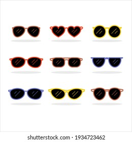 Set of fashionable sunglasses of different shapes, colors, and glasses.