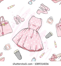 A set of fashionable women's clothing and accessories. Dress, bag, shoes with heels, lipstick, perfume and glasses. Vector illustration. Fashion & Style. Background.