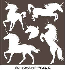 set of fine unicorn silhouettes - running, rearing and jumping magic horses
