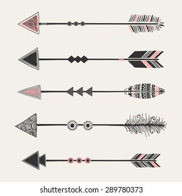 A set of five arrows with tribal decoration in pastel pink and gray on cream background
