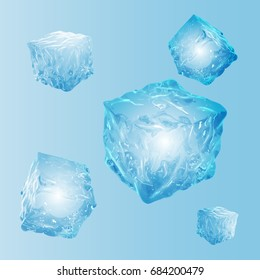 Set of five transparent ice cubes in light blue colors