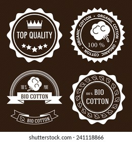 Set of five white flat organic cotton and quality labels.
