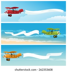 Set of flying airplanes with empty banners for your text. Isolated on white background.