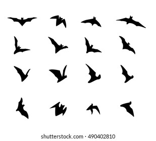 Set of flying bat silhouette icons, vector design