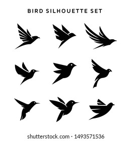 Set of flying birds sign logo vector silhouettes isolated on white