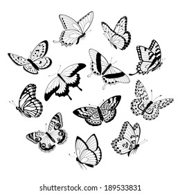 Set of flying black and white butterflies isolated on white background.