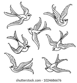Set of flying bluebirds. Free birds. Symbol of happiness, prosperity, trust, love and coming of spring. Old School tattoo design. Black and white illustration