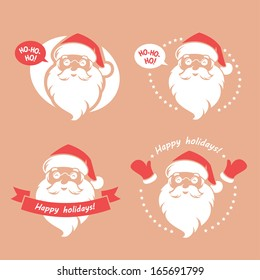 Set of four badges with Santa Clause's face