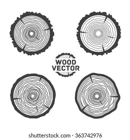 Set of four black isolated vector tree rings background and saw cut tree trunk. Vector illustration