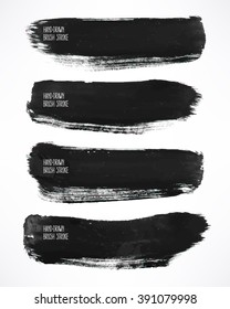 Set with a four black watercolor brush strokes