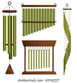 Set of four brass wind chimes on white