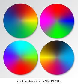 Set of four different color spectrum wheels or circular rainbow gradients.