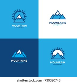 Set of four geometric linear mountain logo in blue and white colors. Winter sport symbol, icon.