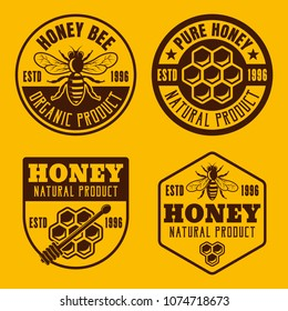 Set of four honey and beekeeping badges, emblems, labels vector illustration on yellow background