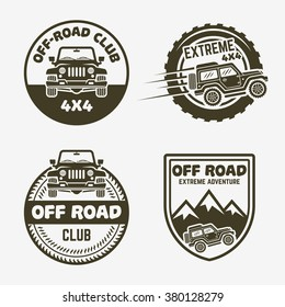 Set of four off-road suv car or 4x4 extreme club monochrome labels, emblems, badges or logos isolated on gray background