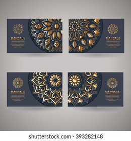 Set of four ornamental gold cards with flower oriental mandala on dark blue background. Ethnic vintage pattern. Indian, asian, arabic, islamic, ottoman motif. Vector illustration. EPS10 clipping mask