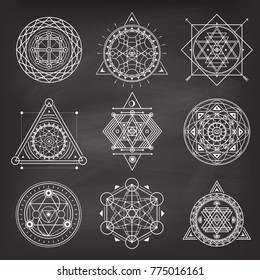 Set of geometry sacred symbols on blackboard background . Vector