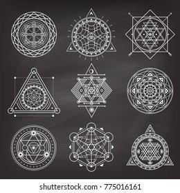 Set of geometry sacred symbols on blackboard background . Vector