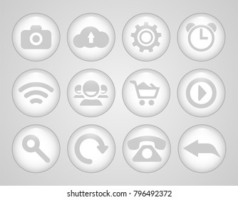 Set of glass icons. Round and volumetric icons of white color.